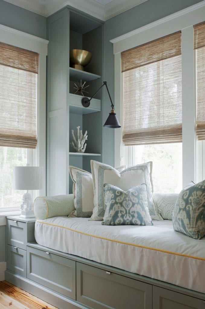 Here is an example of how simple shelving, a built-in daybed, and sconces can transform any small space